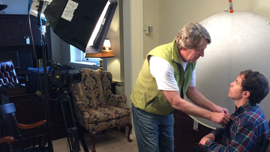 Steve adjusting audio before filming a University of Virginia Educational video.