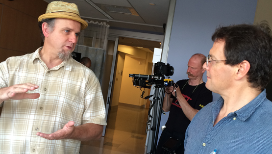 Director, Kent C. Williamson discussing logistics before filming at the UVA Health System.