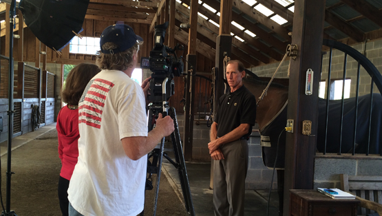 Filming on location, while Tad Coffin shares the history of his saddle business.